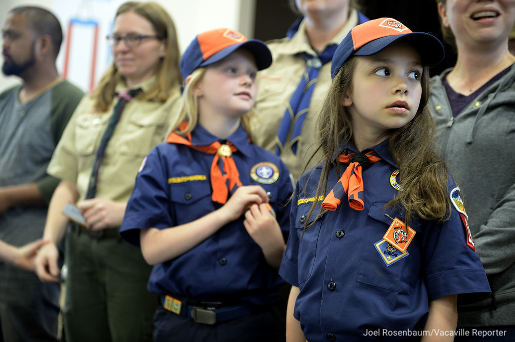 . Emma Thomsen (left) and Teagan Byrd wear their newly earned Tiger badge on their uniform.