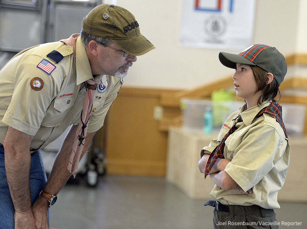 . Cub Scout Pack 191 den leader, Ron Byrd (left) talks with Brenna Perry, 10 of Vacaville during a recent meeting at Foxboro Elementary School. Perry is one of eight girls who have joined the pack as part of the Boy Scouts of America\'s early adopter program.