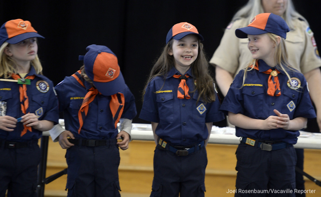 . Member of Tiger Den 1, (from left) Sierra Washington, Lillian Perry Teagan Byrd, and Emma Thomsen, wait to receive their Tiger badge during the monthly pack meeting.