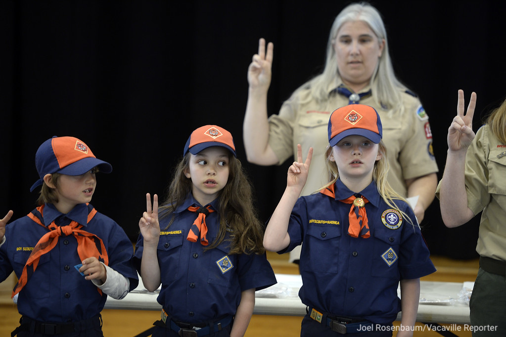 . Cub Scouts, LIllian Perry (left,) Teagan Bryd (middle) and Emma Thomsen lead the pack in the scout oath during the month pack meeting.