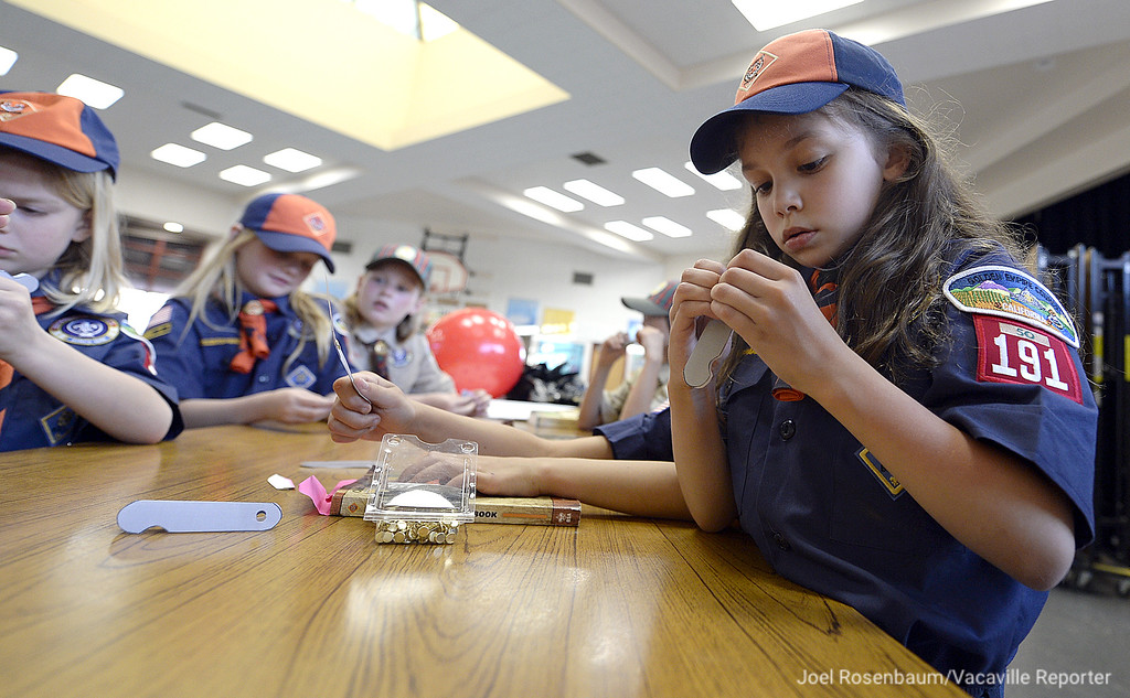 . Teagan Byrd, 7 Vacaville works on assembling paper cutout of knife as she and the rest of the girls in Cub Scout Pack 191 learn about knife safety.