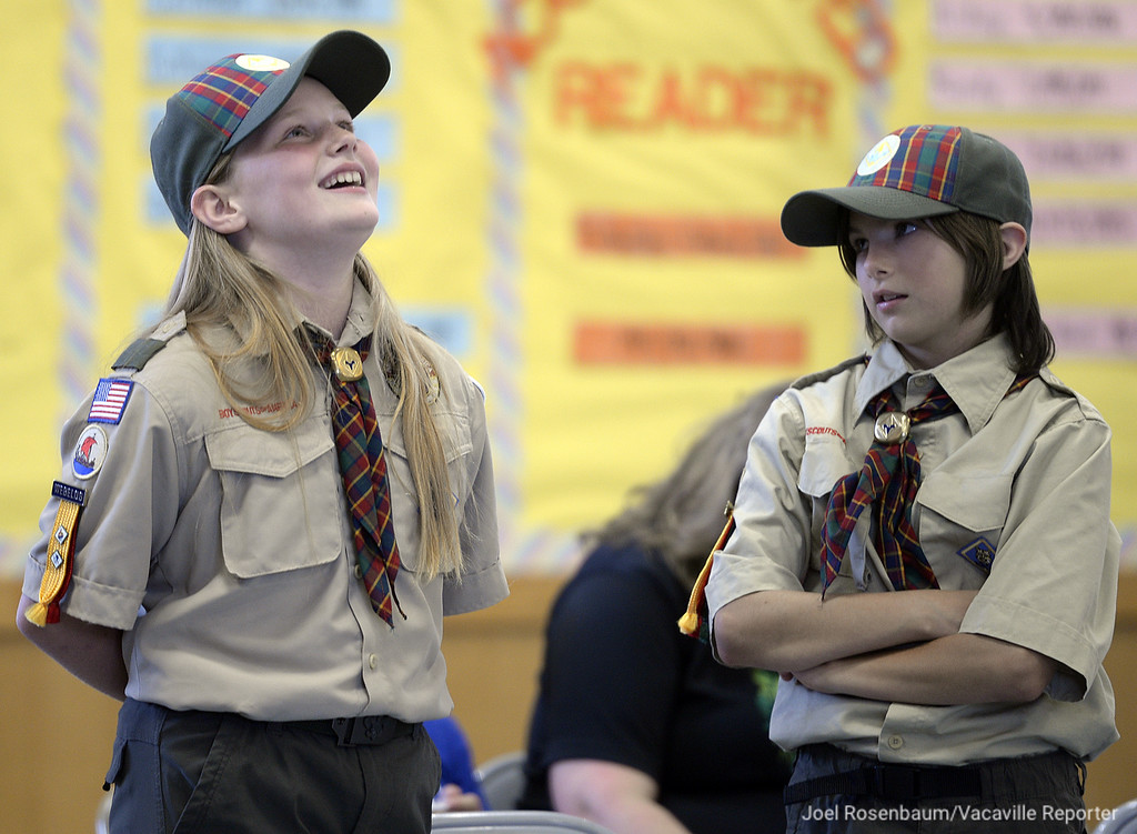 . Lara Thomsen and Brenna Perry both 10 wait to be presented their awards during a the month pack meeting. Both girls are Webelos, and are working toward earning their Arrow of Light and eventually join a scout troop in 2019.
