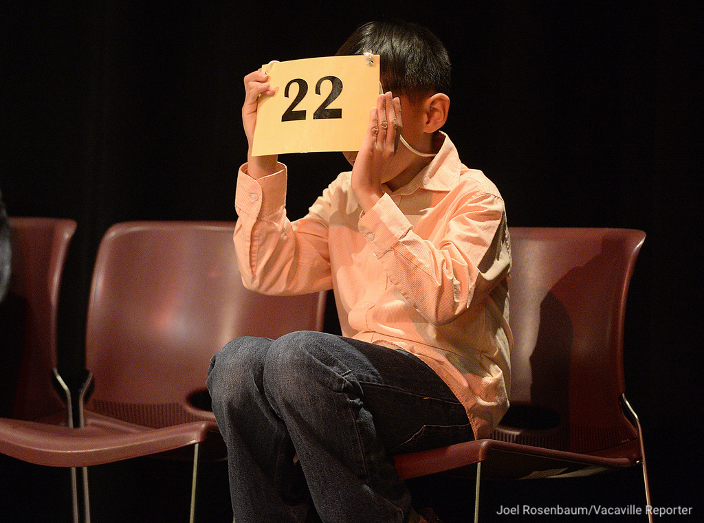 . James Maravilla (right) a fourth grader at Federal Terrace Elementary School in Vallejo plays with his number placard as he waits his turn to compete in the late rounds of the 42nd Solano County Spelling Bee, Tuesday at the Joseph A. Nelson Center in Suisun City.