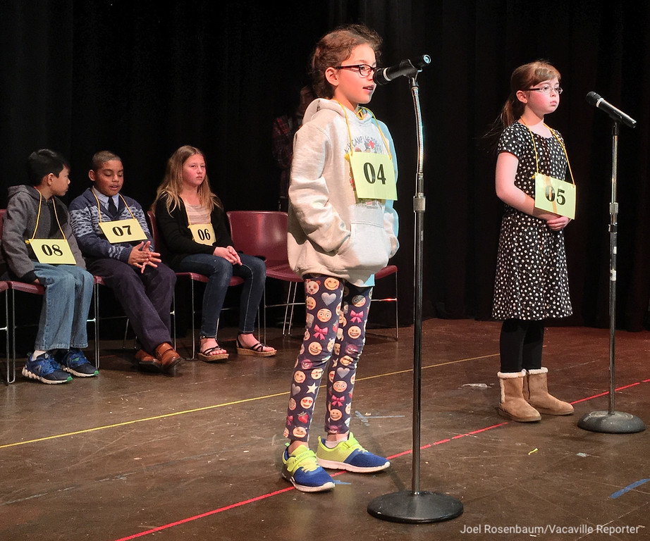 . Rebecca Amar (left) of Vacaville a fourth grader at Cambridge Elementary School competes in the early rounds of the 42nd Solano County Spelling Bee, Tuesday at the Joseph A. Nelson Center in Suisun City.