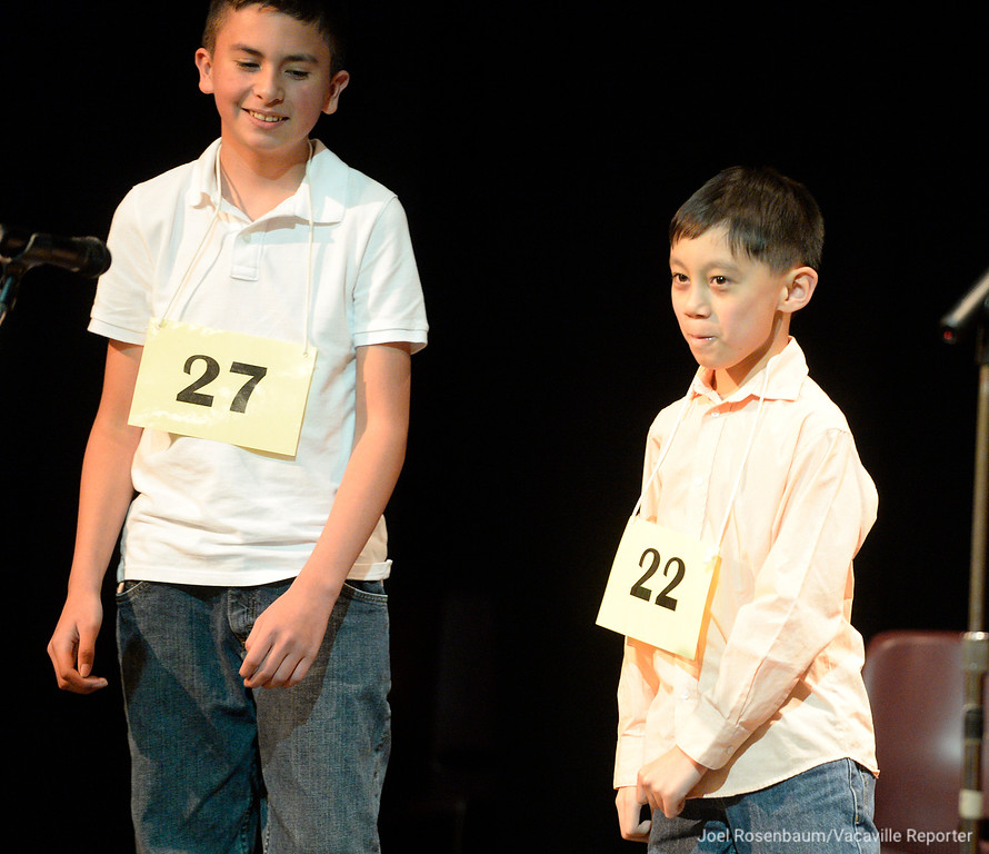 . James Maravilla (right) a fourth grader at Federal Terrace Elementary School in Vallejo smiles as he walks to center stage after it was announced that he had won the 42nd annual Solano County Spelling Bee Tuesday at the Joseph A Nelson Community Center in Suisun City. Diego Gonzalez (left) of Vacaville, a sixth grader a Jean Callison Elementary School finished second. Both boys qualified for the statewide spelling bee.