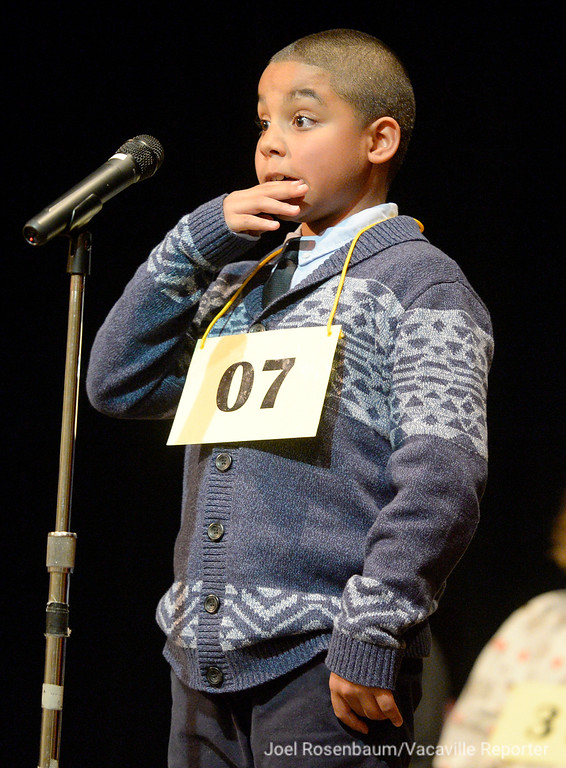 ". Kareem Lewis of Vallejo a fifth grader at Pennycook Elementary School reacts to being told that he spelled the word, ""recolesence\"" correctly during the late rounds of the 42nd Annual Solano County Spelling Bee Tuesday at the Joseph A. Nelson Community Center in Suisun City,"