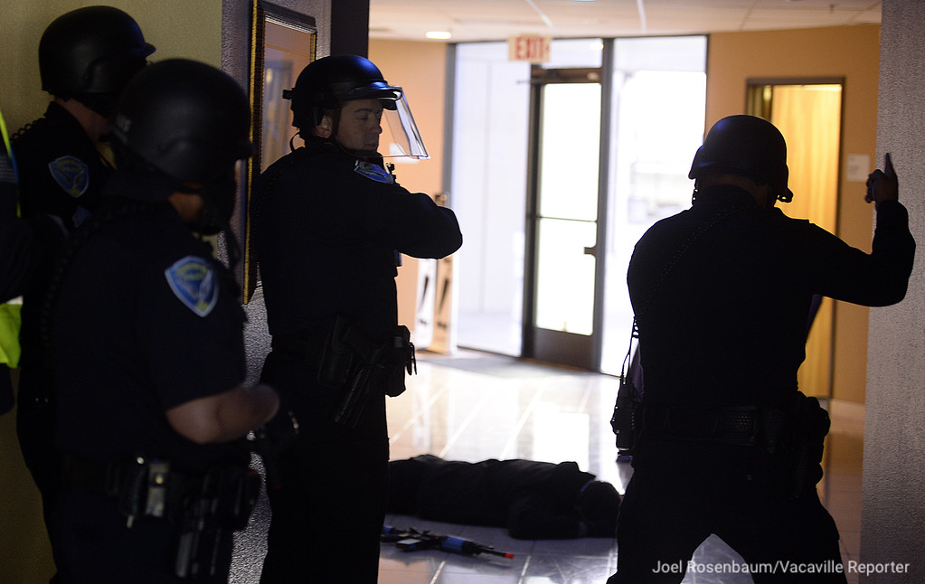 ". Fairfield Police Officers holds their postition they neutralized an ""active shooter\"" during a training exercise Tuesday at the Mt. Calvary Baptist Church."