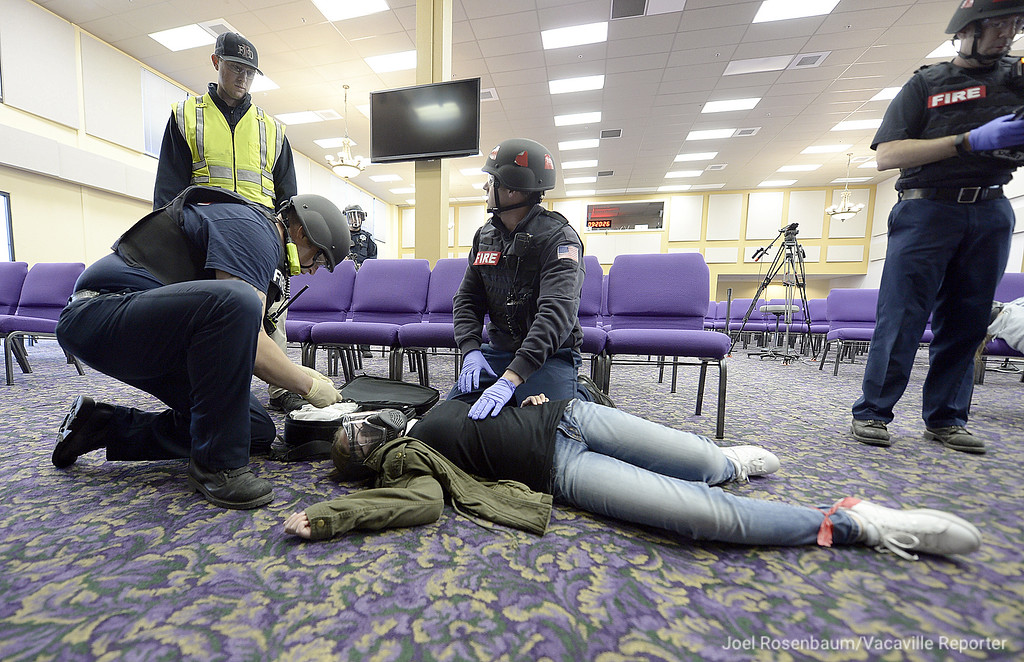 . Personnel from the Fairfield Fire Department perform first aid on one of the stabbing victims during an emergency preparedness drill Tuesday at the Mt. Calvary Baptist Church.