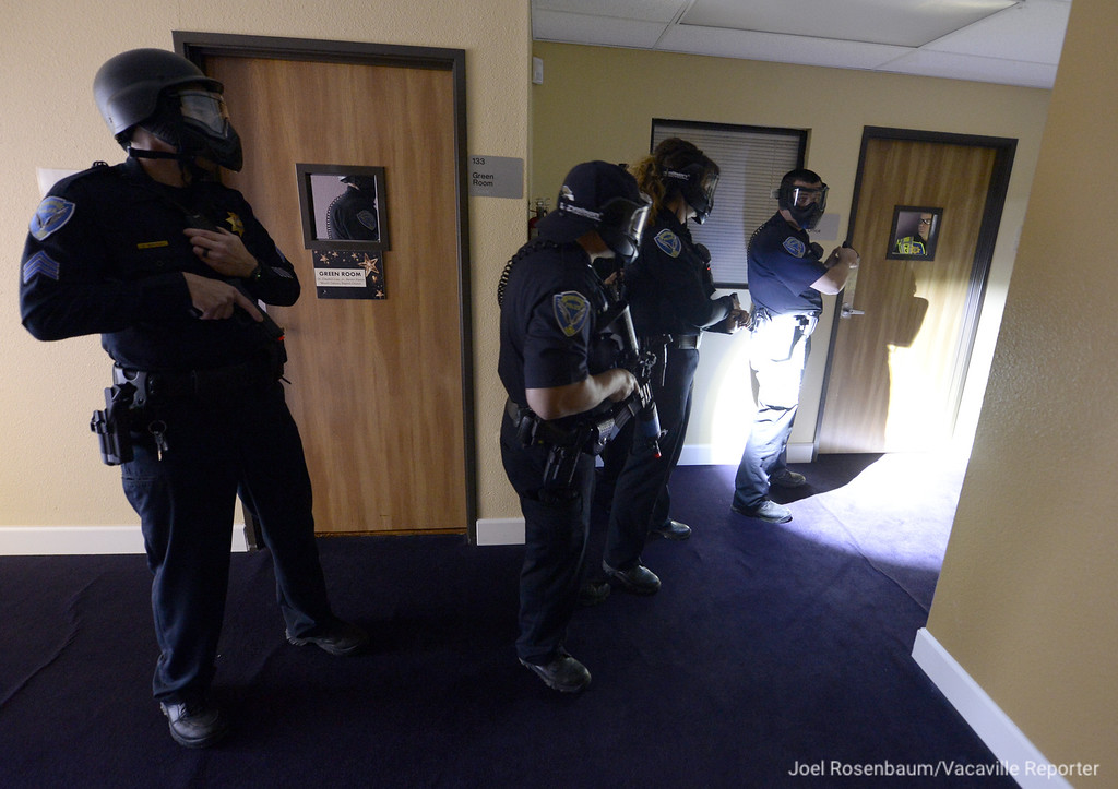 . Officers with the Fairfield Police Department begin negotiations with a suspect who barricaded himself in an office a the Mt. Calvary Church after he stabbed multiple victims including his wife and daughter Tuesday during an emergency preparedness drill.