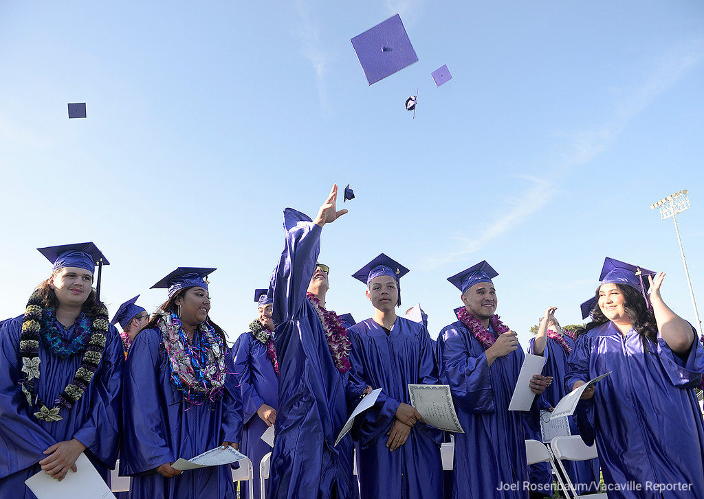 . Members of the Country High School graduating class toss their mortarboards into the air in celebration at the conclusion of commencement ceremonies Thursday at Vacaville High School.
