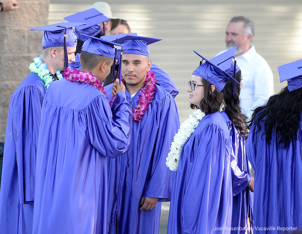. Members of the Country High graduating class hang out before ceremonies Thursday at Vaca High School.