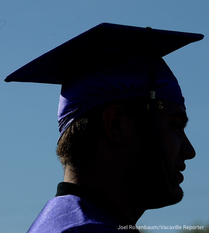 . A County High School graduate, waits to walk in procession to start the ceremony Thursday at Vaca High.