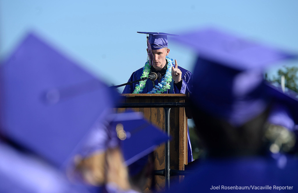 . County High School graduate, Christopher Parker gestures to his fellow classmates as he delivers his remarks during Thursday\'s ceremonies.