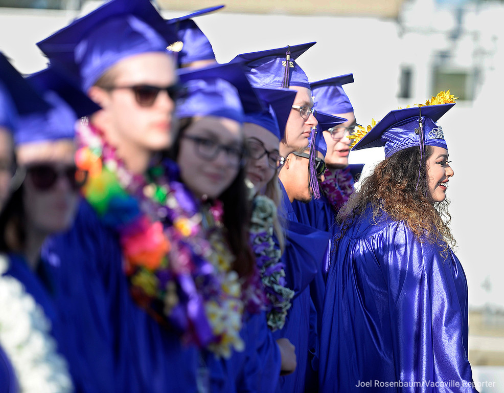 . Graduates stand before taking their seats on the field at Tom Zunino Stadium at Vacaville High School to begin commencement ceremonies Thursday for the 2018 graduating class at Country High School.