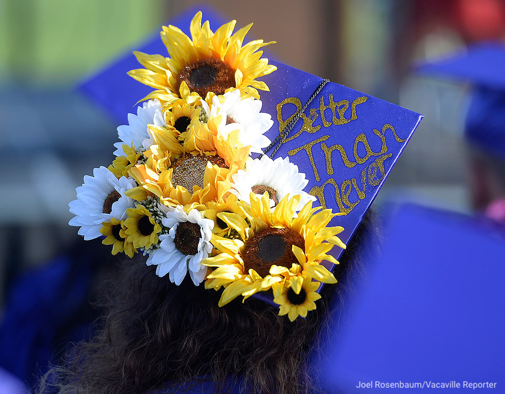 . Flowers and an inspiration message adorn the mortarboard of a Country High School graduate.
