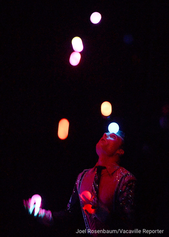 . Juggler, Michael Ferreri performs his routine with lighted balls during the first act.
