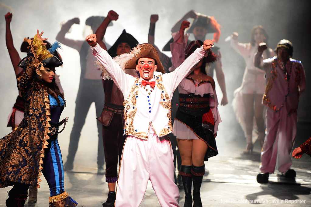 . Circus Vargas clown, Brian Angel Mota celebrates becoming a pirate during the finale off the company\'s opening night performance Thursday in Fairfield. Mota, 20 who is from Portugal is in his first year with this circus after performing for eight years in Europe with his father and uncle who are also clowns and his mother who is an acrobat who have also joined the company too.