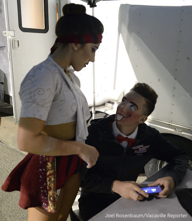 . Mariella Quiroga (left) and Brian Angel Mota share a moment back stage after Mariella finished her performance on the trapeze that kicked off the second act of show.