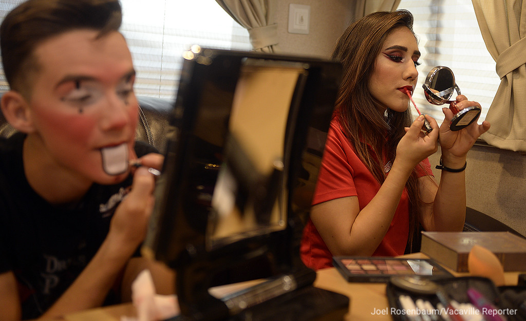 . Brian Mota and Mariella Quiroga apply their makeup as they get ready to perform during opening night of Circus Varagas\' shows in Fairfield.