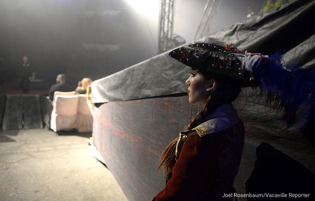 . Circus Vargas trapeze artist and one of the lead pirates, Mariella Quiroga watches the show\'s first act from the wing.