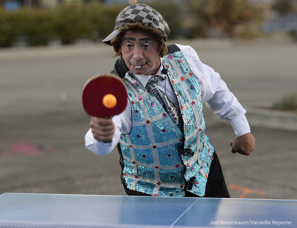 . Circus Vargas clown  clown, Johnny Valentin blow off some pre-show steam by playing a friendly game of Ping-Pong.