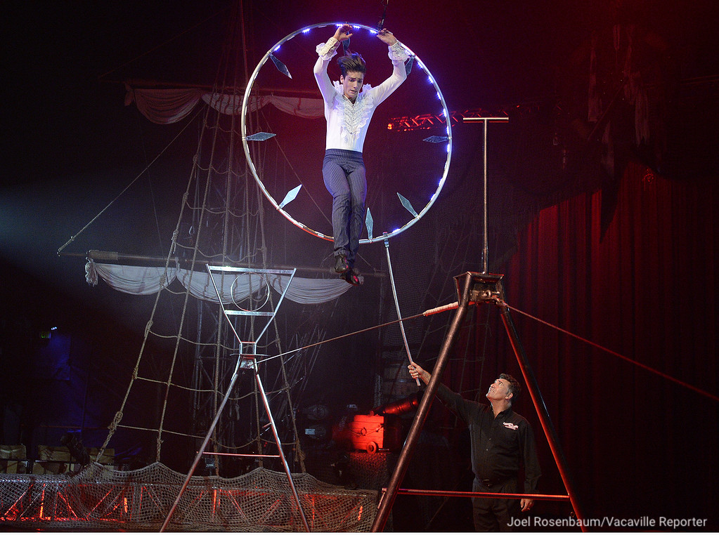 ". Steve Fererri jumps through a large hop as he performs his low wire act during the first act of Circus Vargas\' production of  ""Dreaming of Pirates,\"" Thursday in Fairfield."