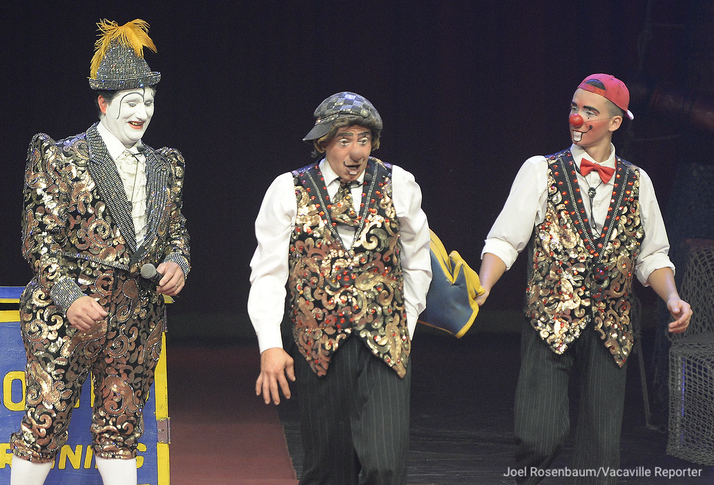 ". Circus Vargas clowns Miguel Mota (left) his brother, Johnny Valentin and his son, Brian Mota perform their routine, ""one-two punch to the delight of the fans inside the big top during opening night Thursday in Fairfield."