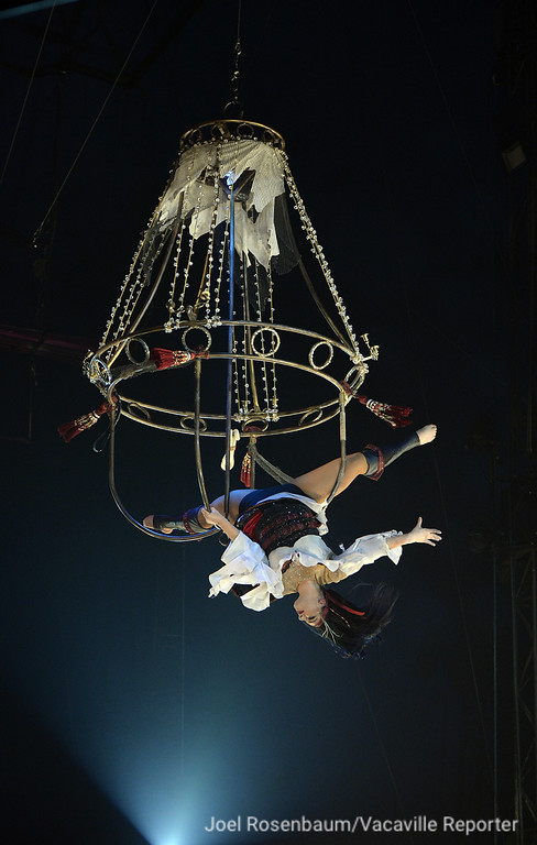 ". Circus Vargas acrobat, Annabel Bachliyski performs her aerial routine from a chandelier hanging from the top of the circus tent during Thursday\'s opening night performance of ""Dreaming of Pirates.\"""