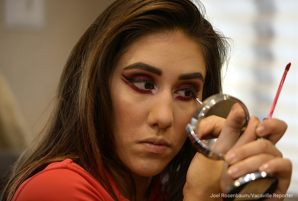 ". Mariella Quiroga, 20 applies her makeup before stepping into the big top to perform in Circus Vargas\' 2018 production, ""Dreaming of Pirates,\"" Thursday in Fairfield. Quiroga has followed in her parents footsteps by becoming a trapeze artist with the show."