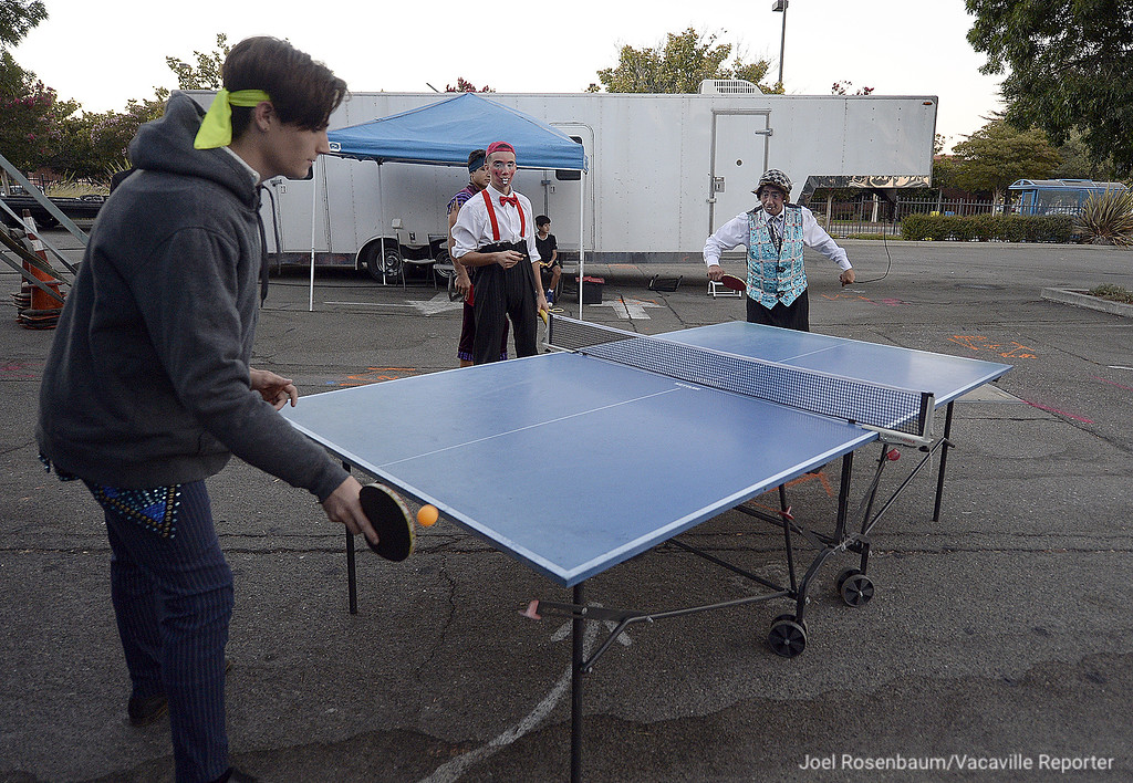 . Circus Vargas performers, tightrope walker, Steven Fererri and clown, Johnny Valentin blow off some pre-show steam by playing a friendly game of Ping-Pong.