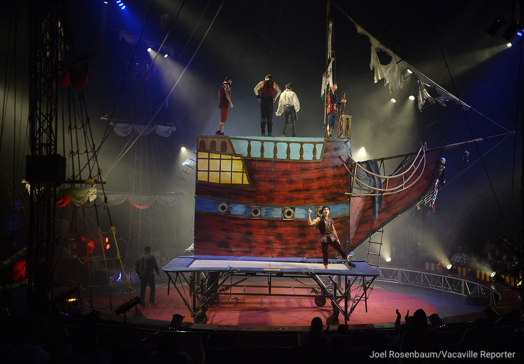. Circus Vargas acrobats perform stunts on  trampolines placed below a pirate ship in the center ring of the big top during the Thursday\'s opening night show in Fairfield.