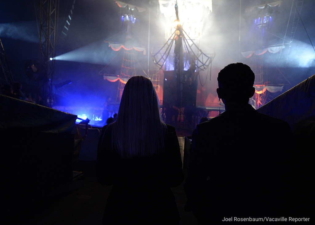 . Circus Vargas owners, Katya and Nelson Quiroga watch the opening night performance from the wings. The two started out as performers in the show as trapeze artists and then purchased the company in 2005.