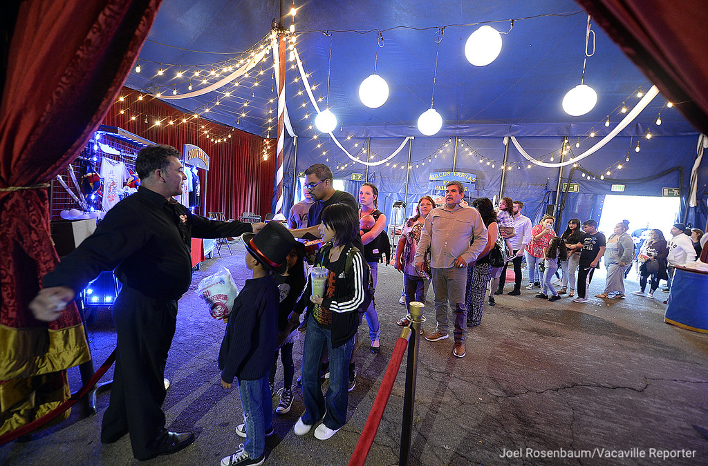 . Circus fans line up to get into the Circus Vargas big top for Thursday\'s opening night performance in Fairfield at the Solano Town Center.