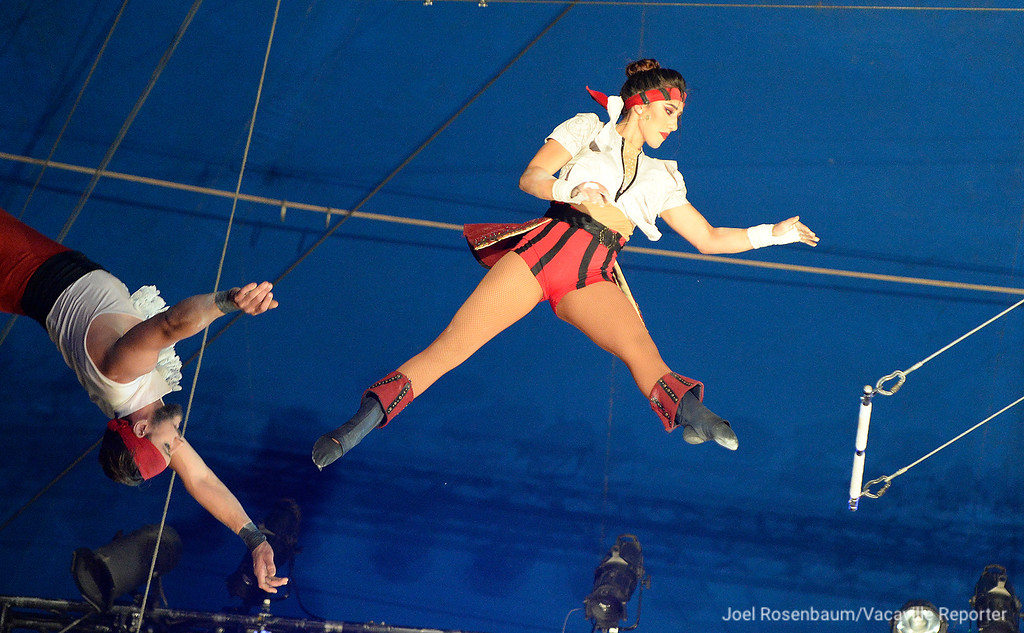 . Circus Vargas\' Mariella Quiroga soars through the air as she performs on the trapeze with Tad Payne-Tobin (left) during Thursday\'s night\'s show. Quiroga grew up watching her parents perform in the circus.