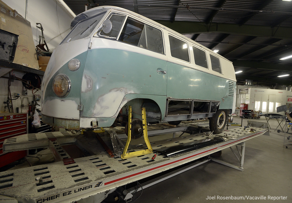 """. A 1963 Volkswagen Micro bus sits on a lift at Vacaville Auto Body Center owed by Robert and Marlo Skinner. The van is currently being restored at the shop by Robert Skinner and his crew who will then ship to the east coast where it will be painted to be an accurate representation of the iconic \""""Light Bus\' by muralist Dr. Bob Hieronimus who also painted the original van in 1968. The whole process of the search for the original van and the replacement is being filmed for a television program by John Westly Chisholm."""