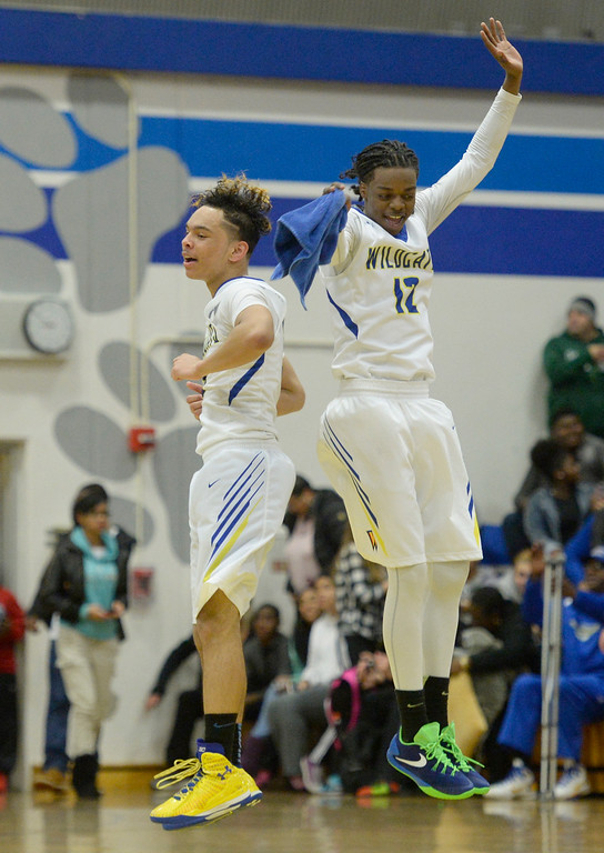 . Will C. Wood\'s Alex Stepney (left) and Damontre Gidron celebrate after time expired in the Wildcats 58-53 victory over rival Vaca High on Friday at Wood. Joel Rosenbaum -- The Reporter