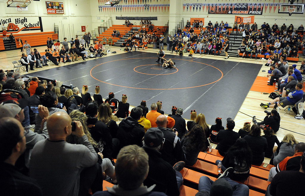 . Wrestling fans from Vacaville and Will C. Wood High School fill the Harold Youngblood Gymnasium to watch the two school battle it out on the mat on Wednesday night. The Bulldogs won the meet for their 105 straight league victory and captured the MEL Duel Meet Title. Joel Rosenbaum -- The Reporter
