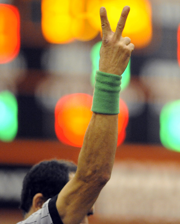 . The referee signals for a score during a match.  Joel Rosenbaum -- The Reporter