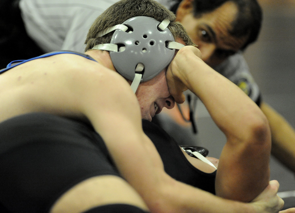 . Wood\'s Cody Healer gets a hand in the face from Vaca High\'s James Ramos during their 145lbs match on Wednesday at Vaca High. Healer won the match 16-4 but the Wildcats lost the match to their rivals 47-13. Joel Rosenbaum -- The Reporter