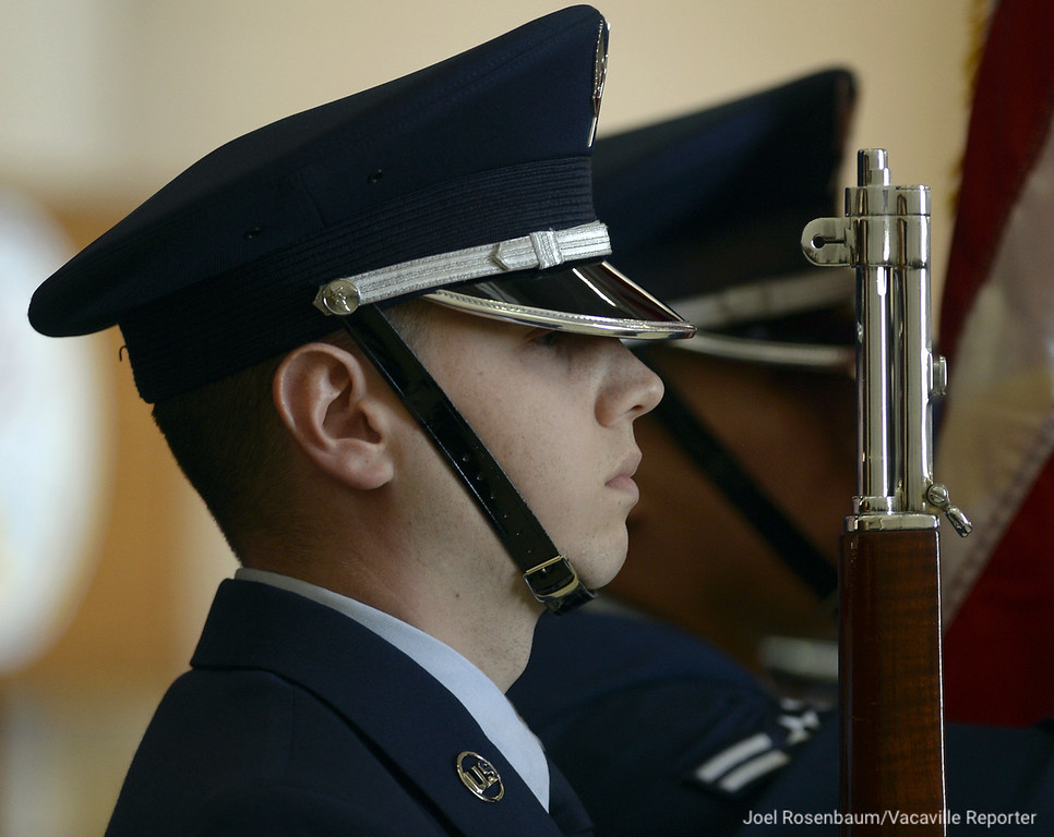. A member of the honor guard at Travis Air Force Base stands at attention as the national anthem is sung during the Travis Air Force Base\'s 75th Anniversary Celebration Thursday on base. Joel Rosenbaum -- The Reporter