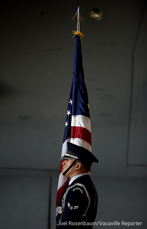 . A member of the honor guard at Travis Air Force Base stands at-ease before the start of Travis Air Force Base\'s 75th Anniversary Celebration Thursday on base. Joel Rosenbaum -- The Reporter