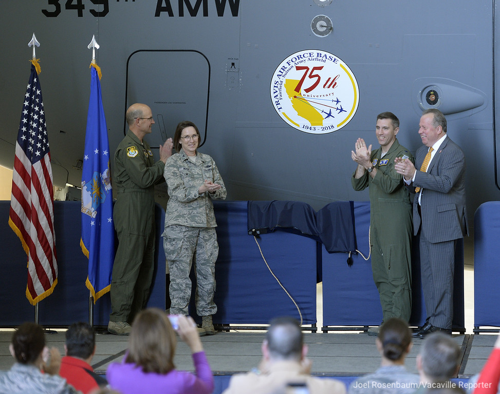 . United States Air Force Col. Raymond A. Kozak, commander of the 349th Air Mobility Wing, (left)  Col. Ruth Meyer of the 621 Contingency Response Wing, (second from left) Col. John Klein, commander of the 60th Air Mobility Wing and California State Senator, Bill Dodd applaud after unveiling the special 75th Anniversary logo on the nose of C-17 at the conclusion of ceremonies Thursday at Travis Air Force Base. Joel Rosenbaum -- The Reporter