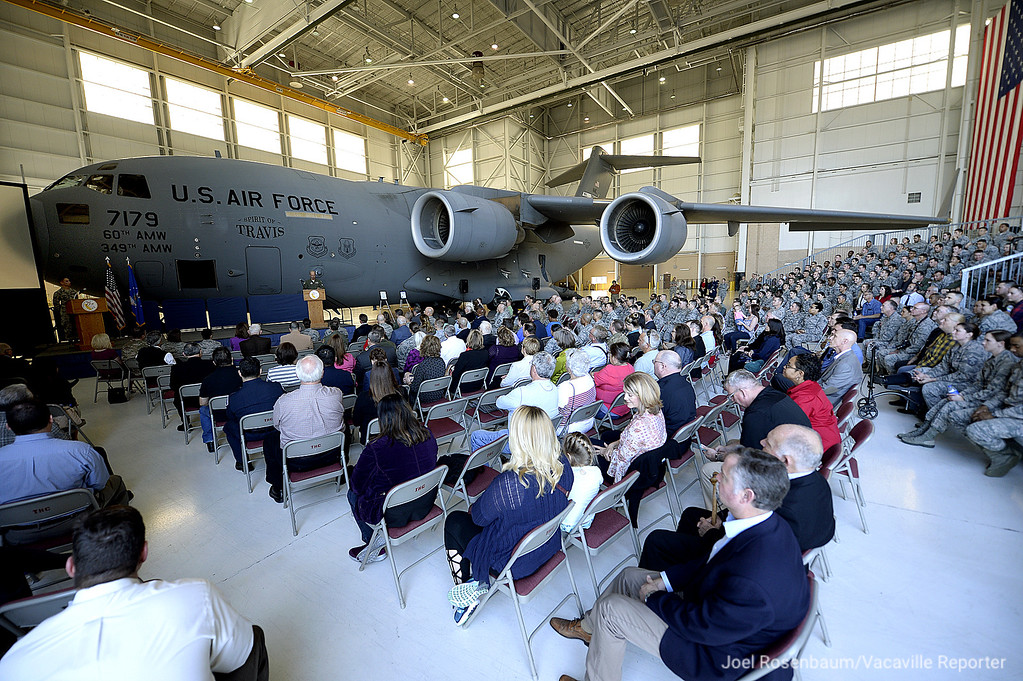 . Dwarfed by a C-17 Globemaster, United States Air Force Col. Raymond A. Kozak, commander of the 349th Air Mobility Wing delivers his remarks during a 75th Anniversary Ceremony for Travis Air Force Base Thursday on base. Joel Rosenbaum -- The Reporter