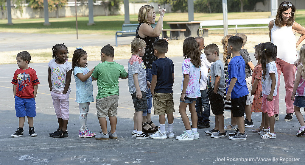 . Tremont Elementary School kindergarten teacher. Mia Lodigiani takes her new students on a tour of the campus before recess and snack timeThursday, the first day of school in Dixon.
