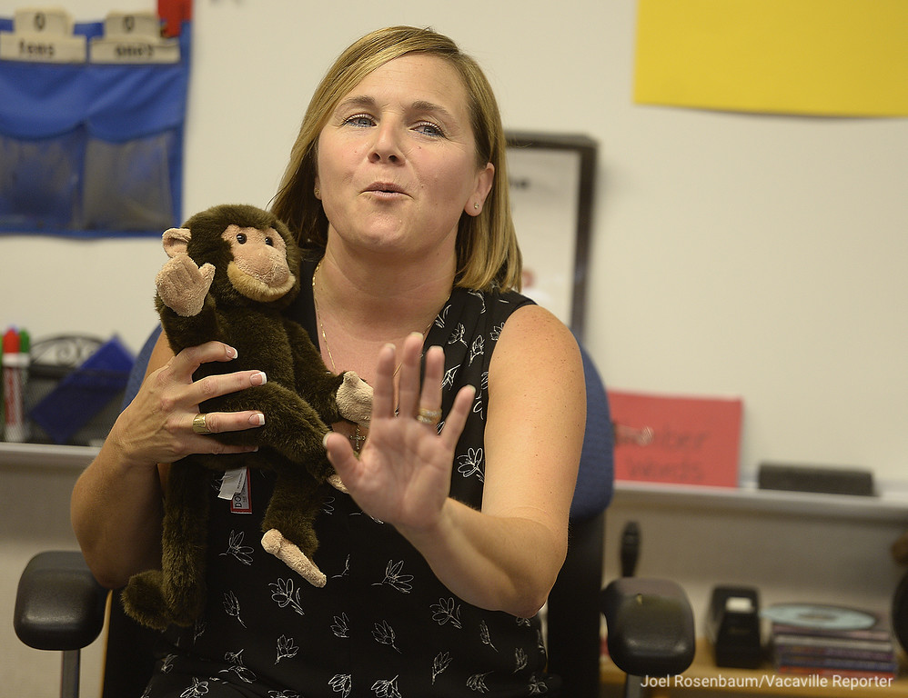 """. Using a stuffed animal know as \""""Mike the Monkey\"""" Tremont Elementary School kindergarten teacher, Mia Lodigiani explains the class rules to her new students on the first day of school in Dixon."""
