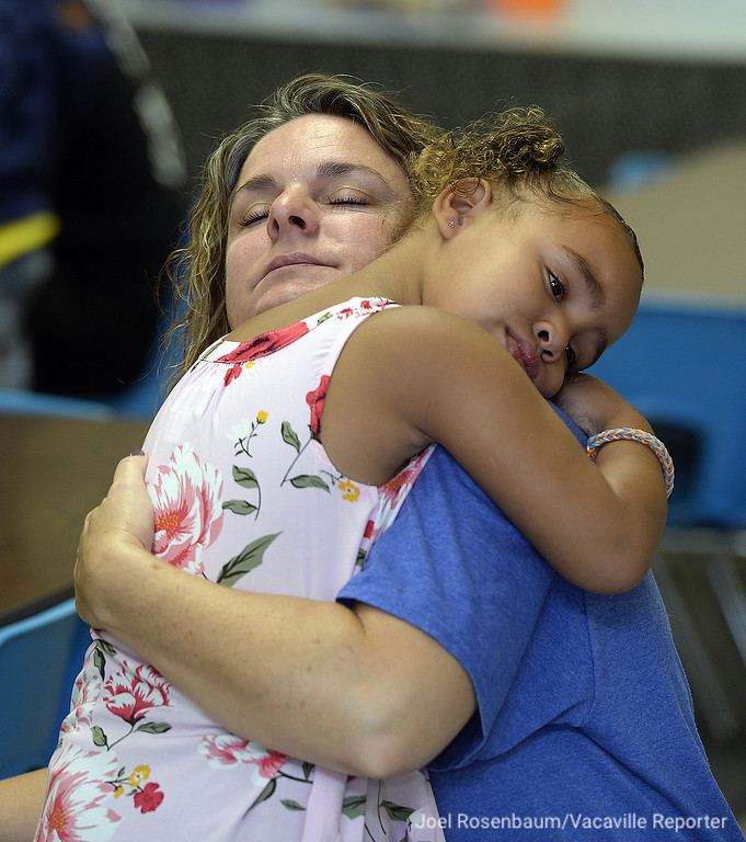 . Ilanna Okhomina, 5 of Dixon gives her mother, Tammy  a big goodbye hug as she leaves her kindergarten classroom  at  Tremont Elementary School Thursday on the first day of school in Dixon. Okhomina said that unlike her three older children, Ilanna didn\'t go to preschool so she was both nervous and excited for her first day.