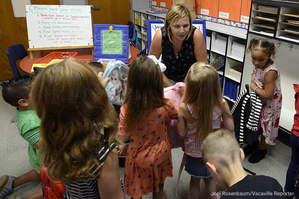 . Tremont Elementary School kindergarten teacher, Mia Lodigiani welcomes her new students into the classroom Thursday on the first day of school in Dixon.