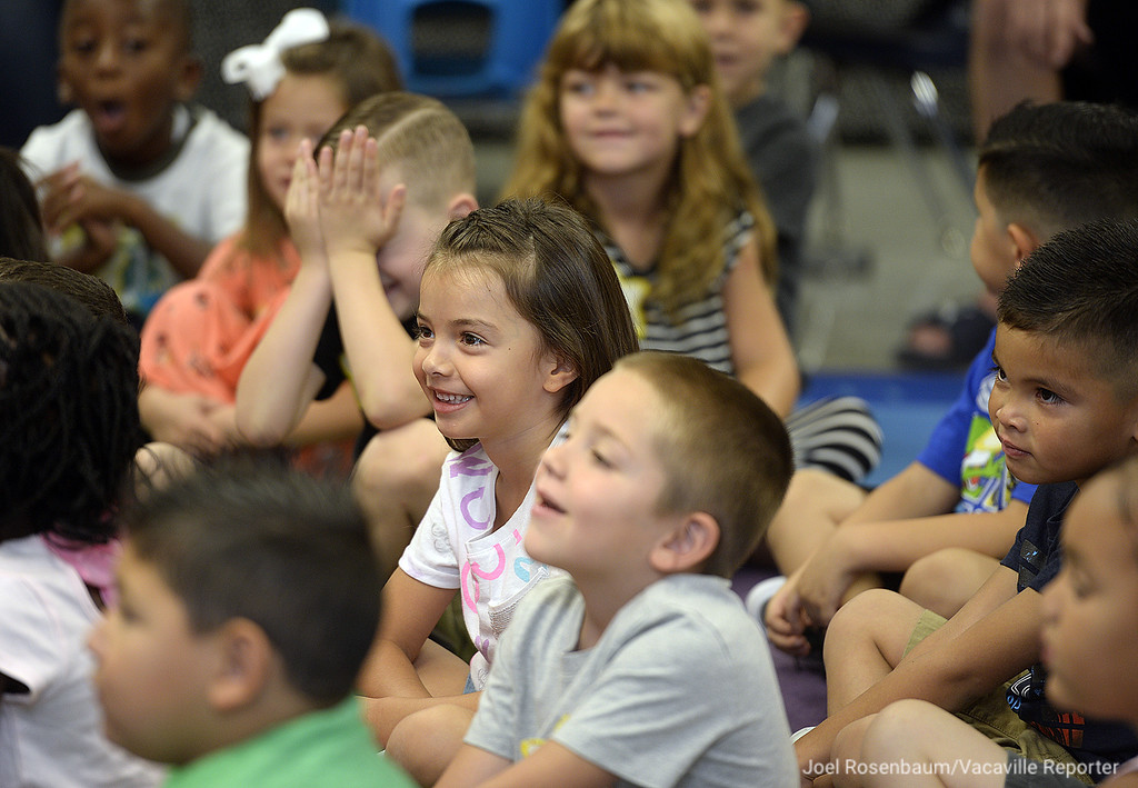 . New kindergarten students at Tremont Elementary School react as their teacher, Mia Lodigiani tells them a funny story during their first day of school in Dixon.