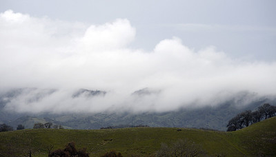 Clouds hang low along the foothills of the Suisun Valley. According to the National Weather Service, heavy rain is expected today with both high wind and flood warnings in effect till Wednesday morning. Joel Rosenbaum -- The Reporter