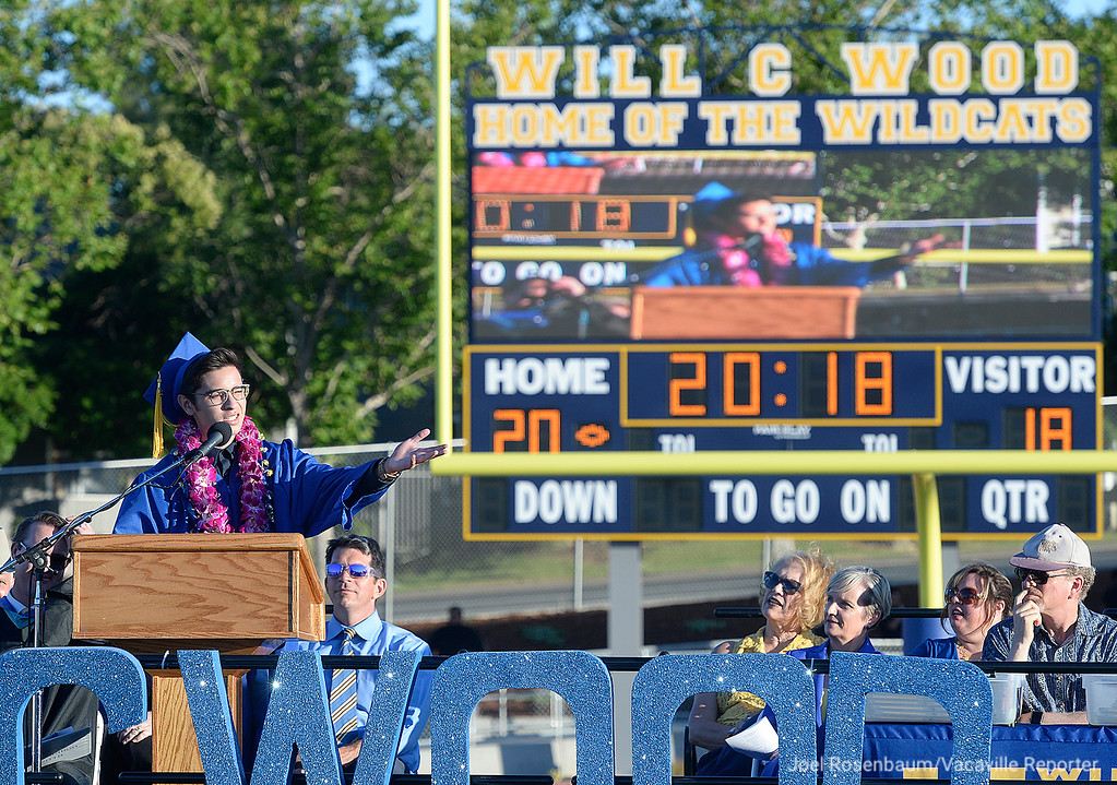 . Senior Class President, Brendan Linehan delivers his remarks during graduation ceremonies Friday at Wildcat Stadium. Linehan cut his speech short to screen a video he made to thank his classmates, teachers, parents and his grandfather.